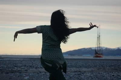 dancer in arctic landscape