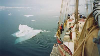boat near iceberg