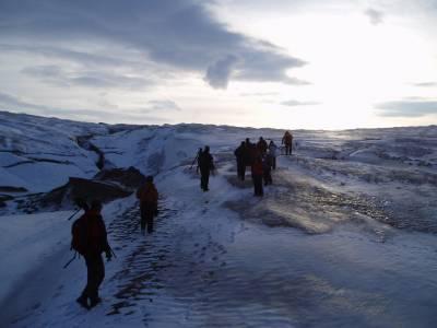 figures walk in Arctic landscape
