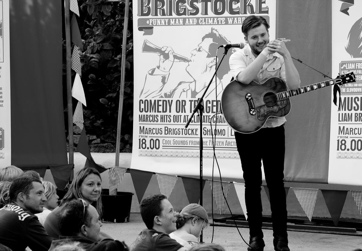Liam Frost performing in Eden's Mediterranean Biome