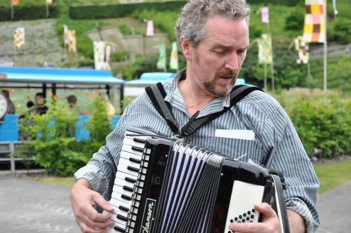 man plays instrument
