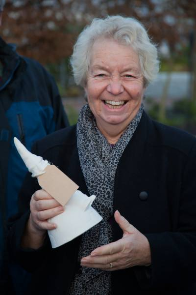 woman holds garden gnome