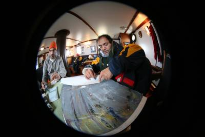 fish-eye of person painting