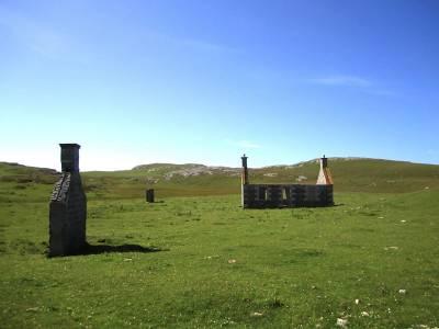 building ruins in vast landscape