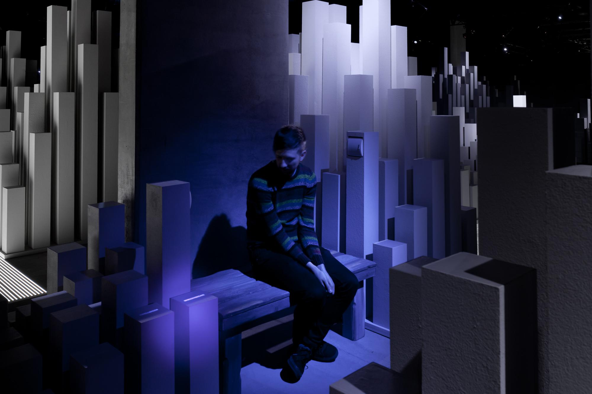 figure sitting in immersive installation