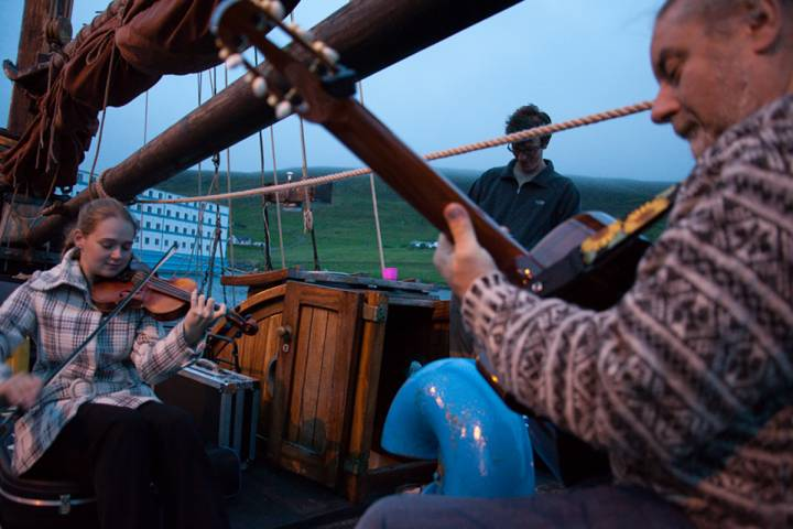 musicians play on boat deck
