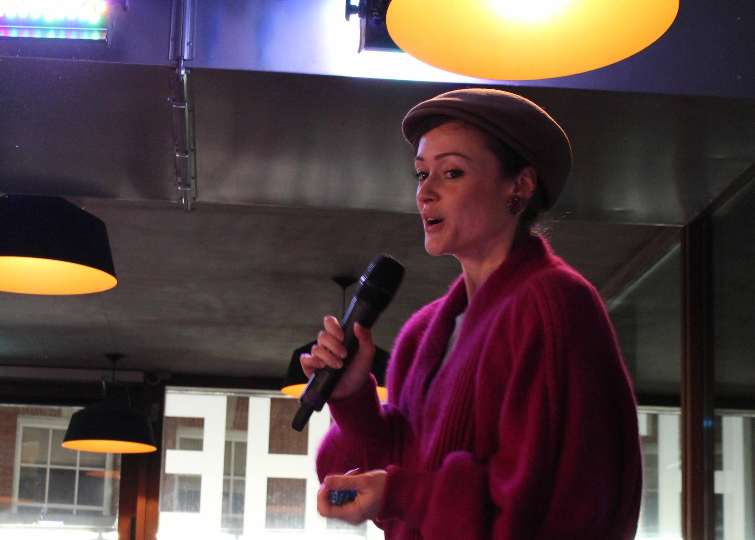woman performing poetry on intimate stage