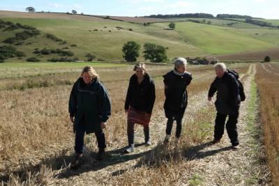 group walks in farming field