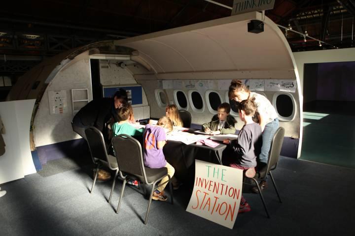 children take part in a creative workshop