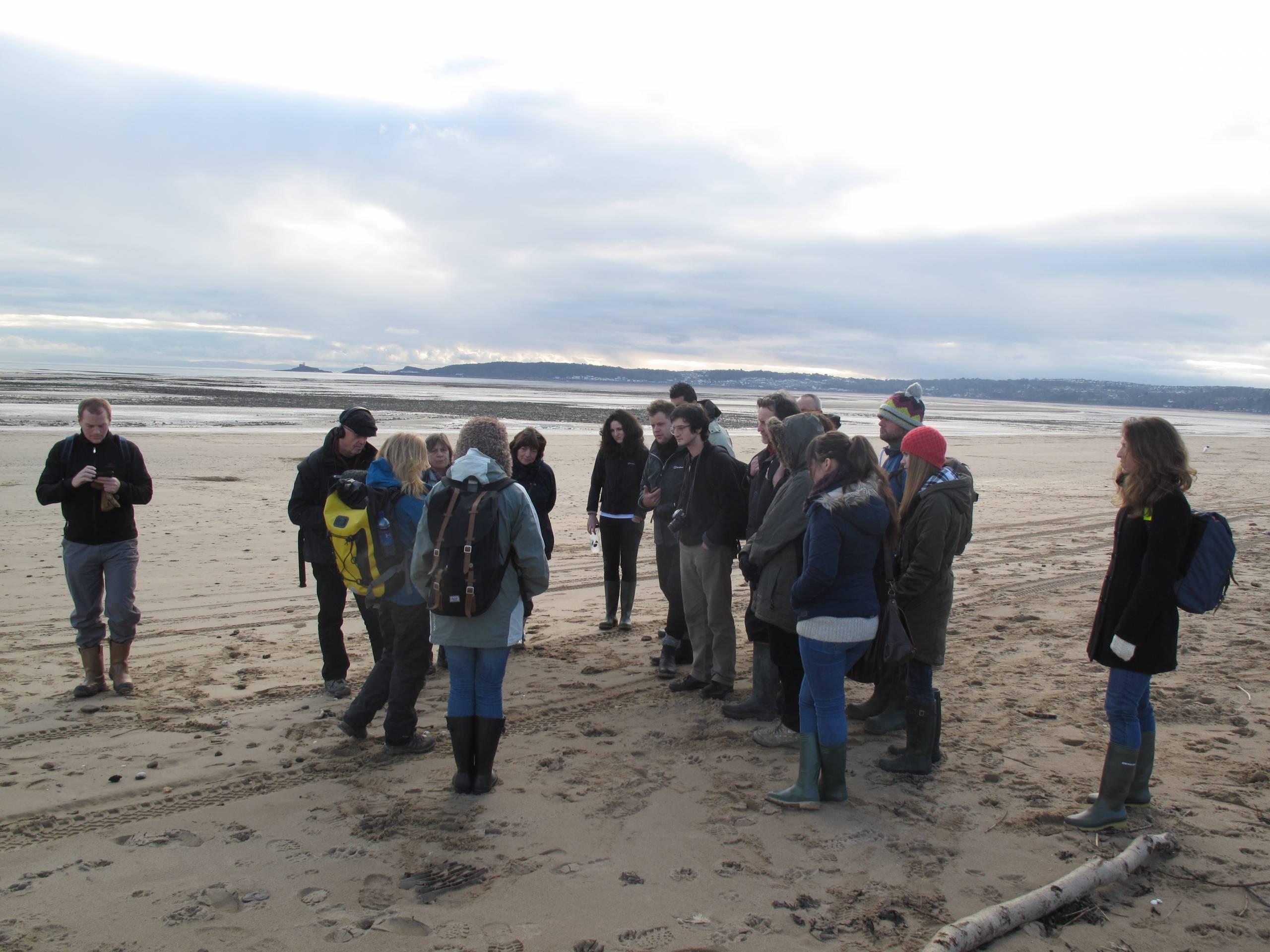 group walks on beach