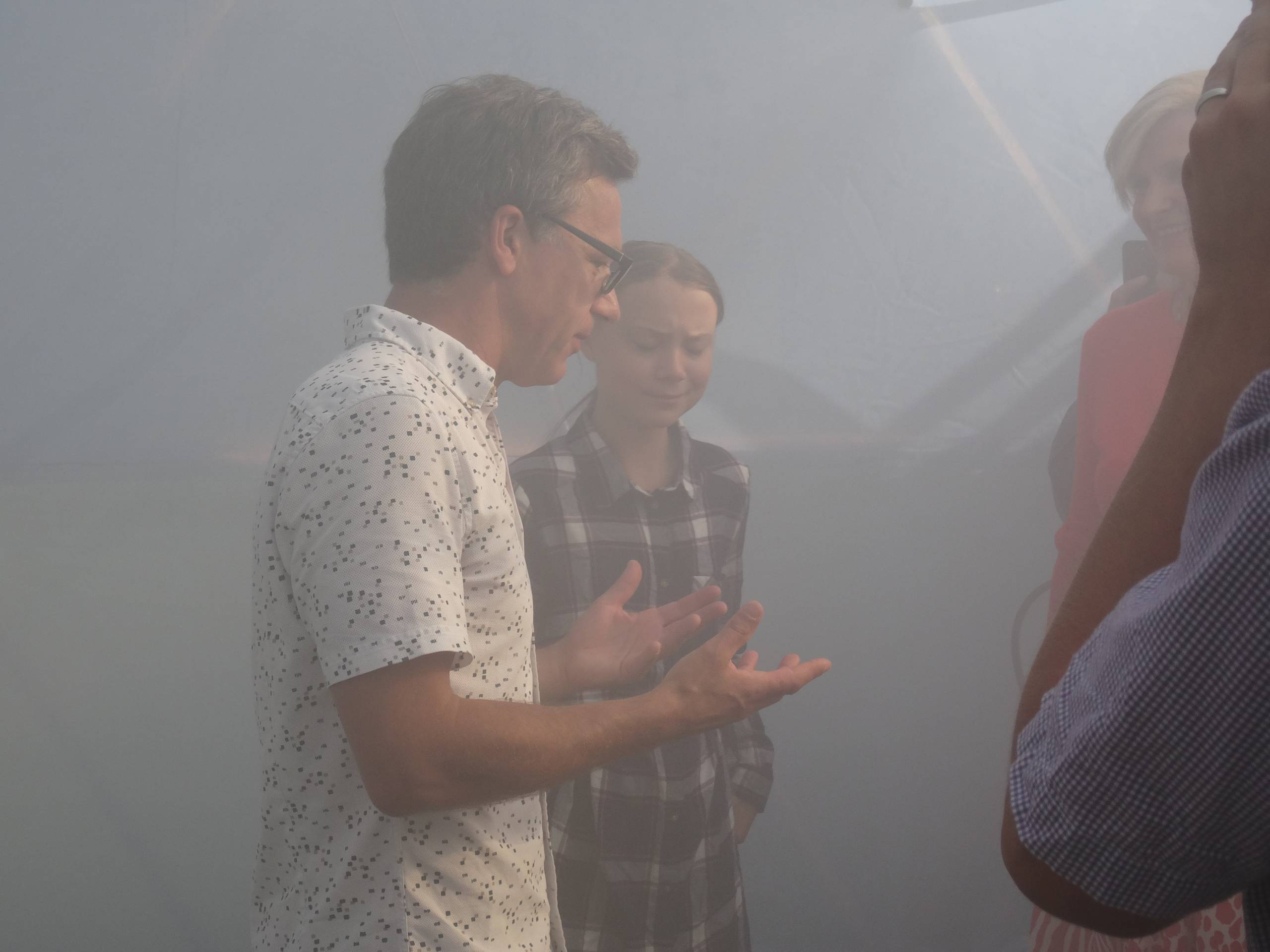 two people talk in smoggy atmosphere