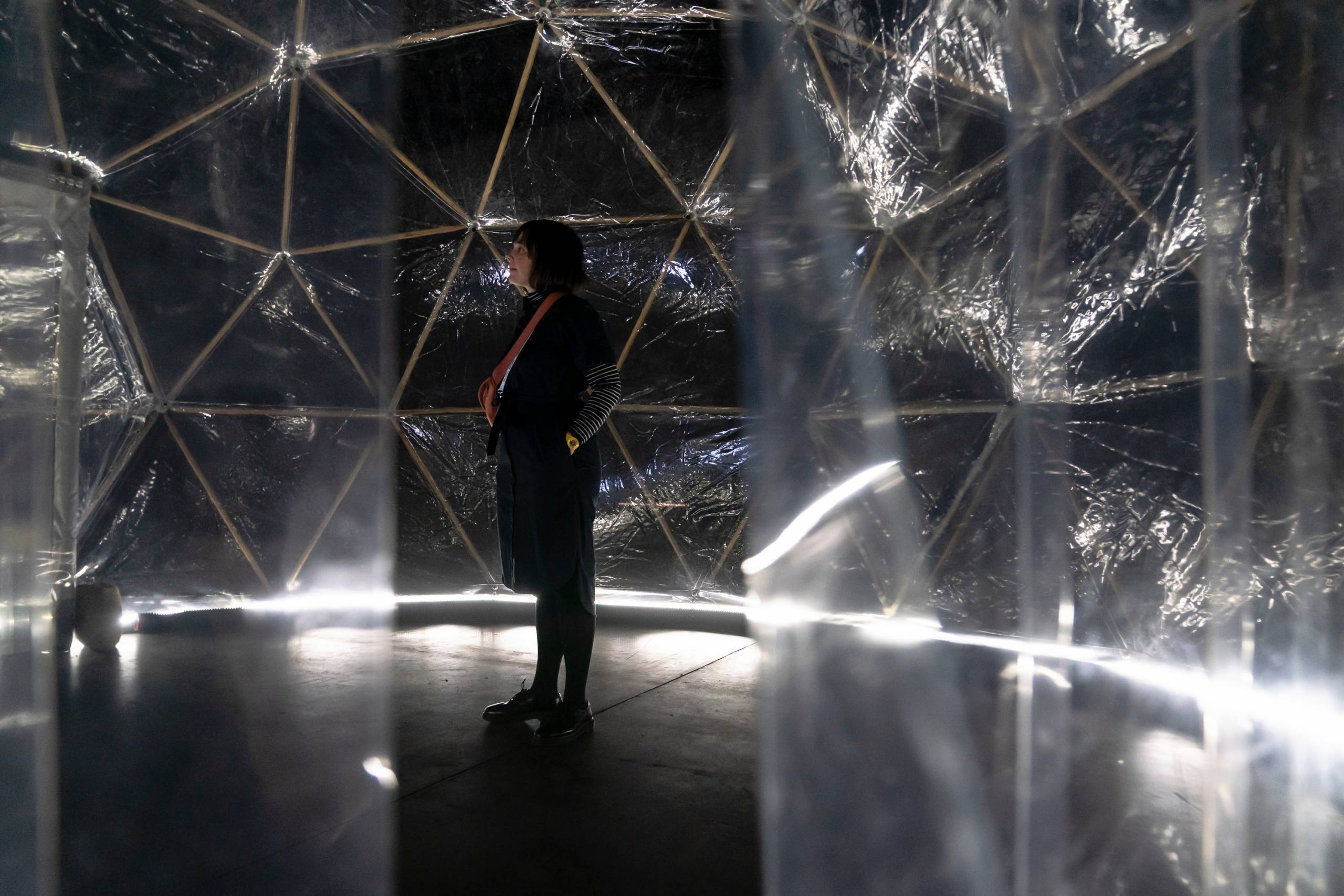 woman experiencing the Pollution Pod artwork