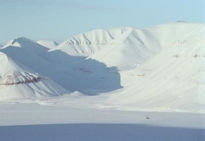 boat locked in ice in a vast Arctic landscape