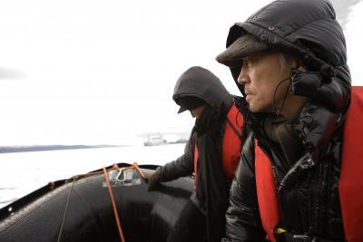 figures in Arctic gear onboard a zodiak