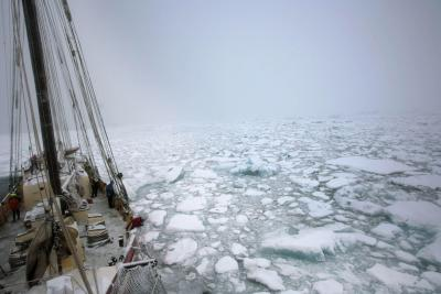 boat sailing through heavy ice in Arctic waters