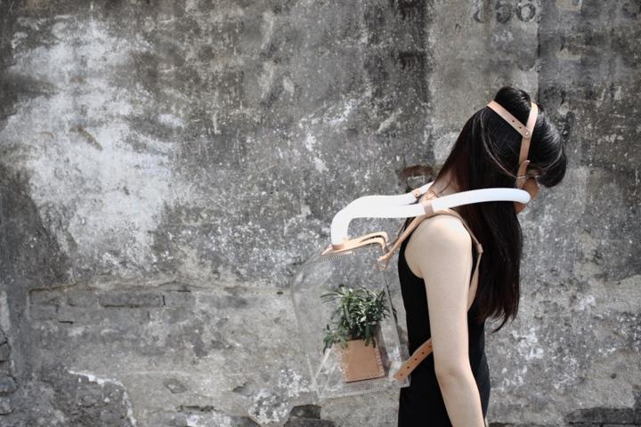 woman wears breathing apparatus artwork