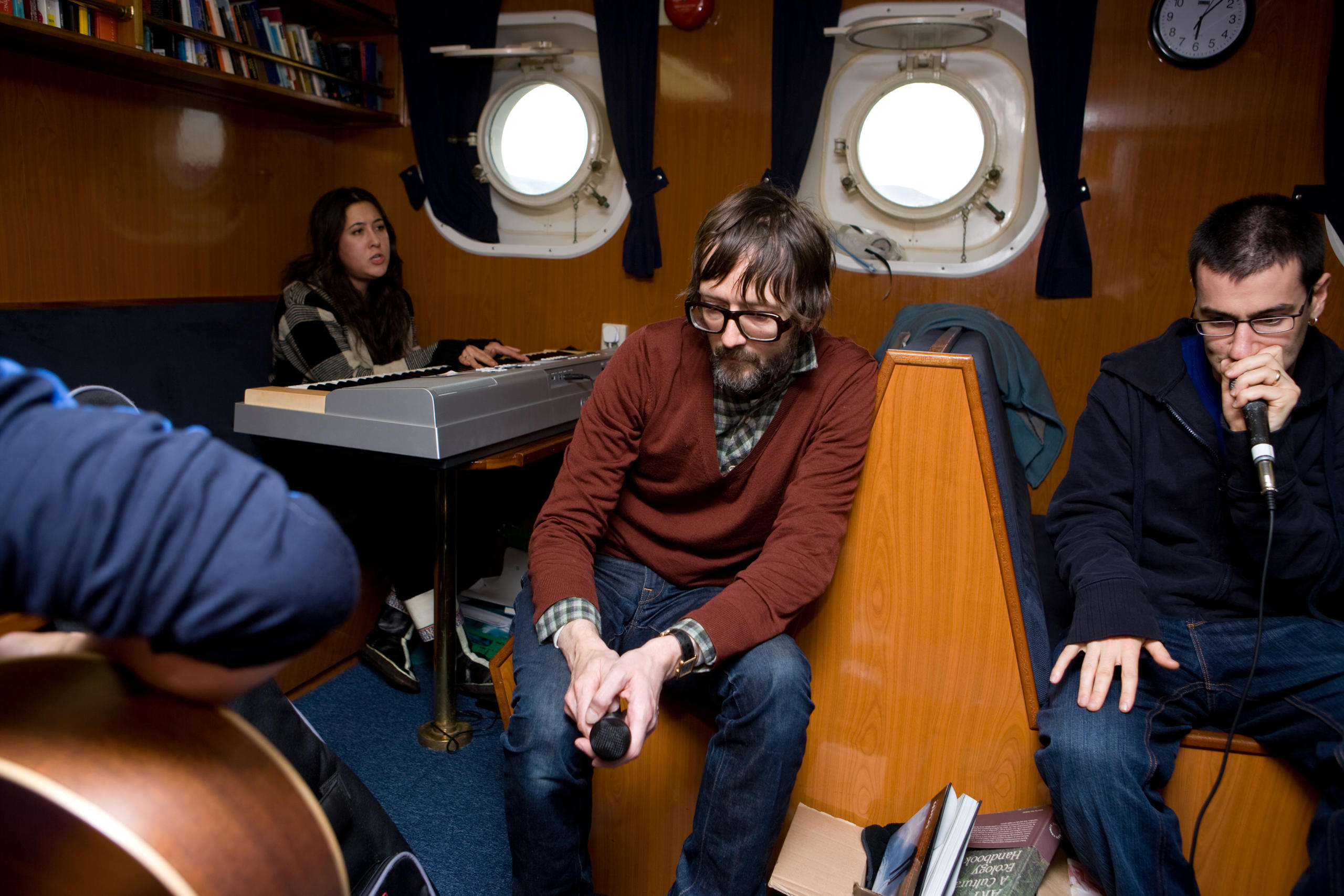 musicians jamming in a boat cabin