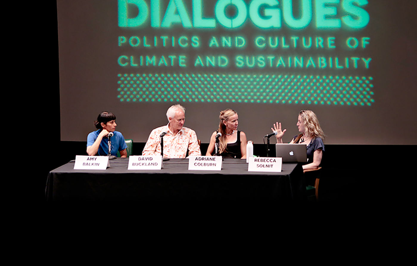 four people on stage during a panel discussion
