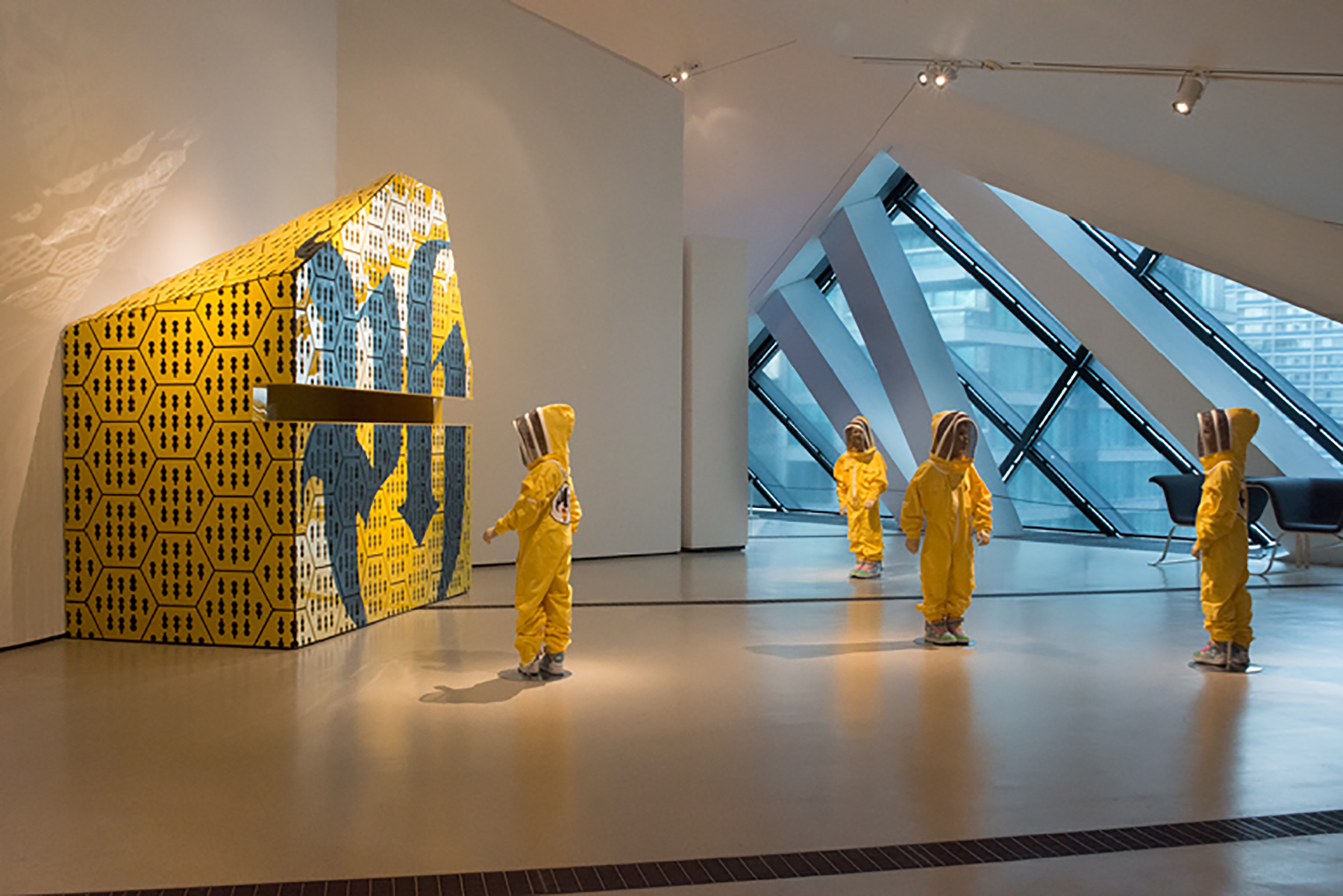 graphic yellow bee hive and figures in beekeeping suits