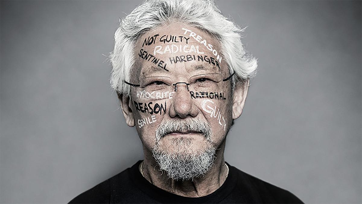 """portrait of David Suzuki with """"guilty, rational, radical"""" painted on his face"""