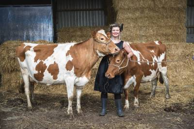 woman in dress with milking cows