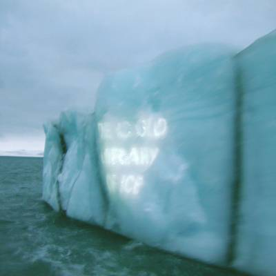 text projected on iceberg