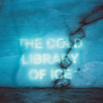 The Cold Library of Ice projected text on iceberg