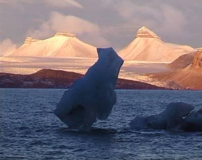 iceberg falling into the sea