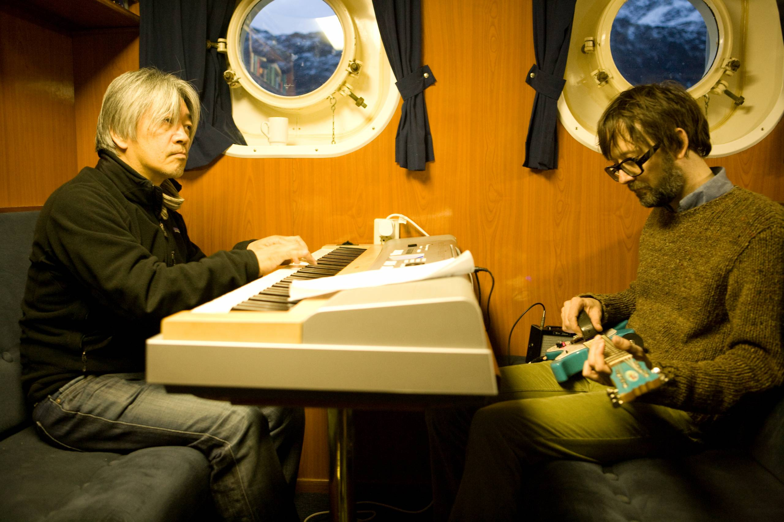 musicians in a boat cabin