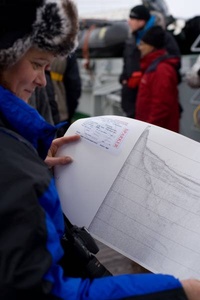 scientist holding a map