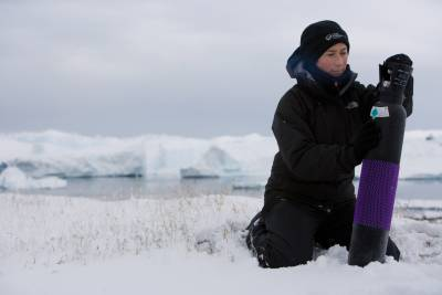 woman with gas cylinder in an Arctic environment