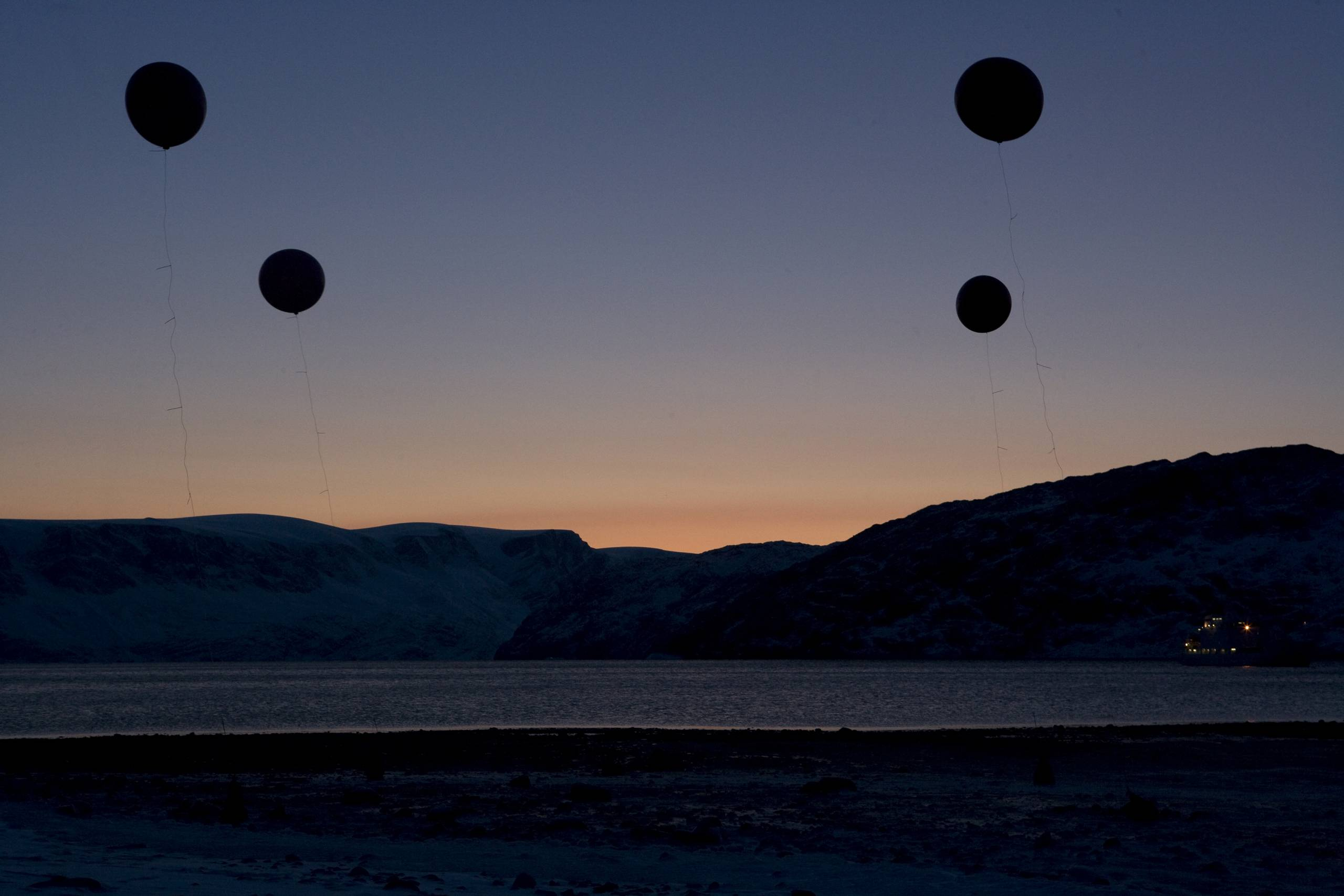 weather balloons in an Arctic landscape