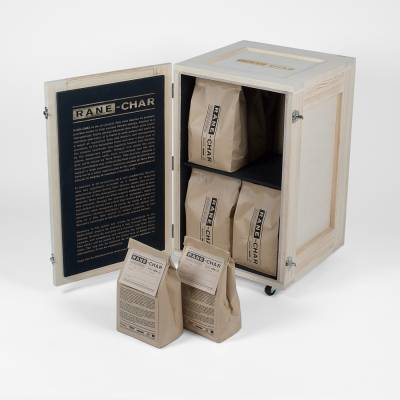 box containing packs of charcoal
