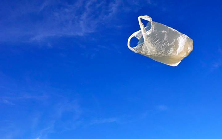 plastic bag flying against blue sky