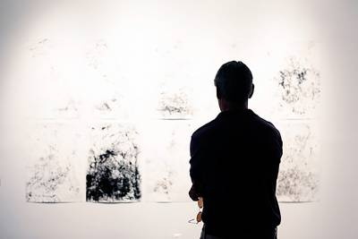 man viewing artwork in an exhibition