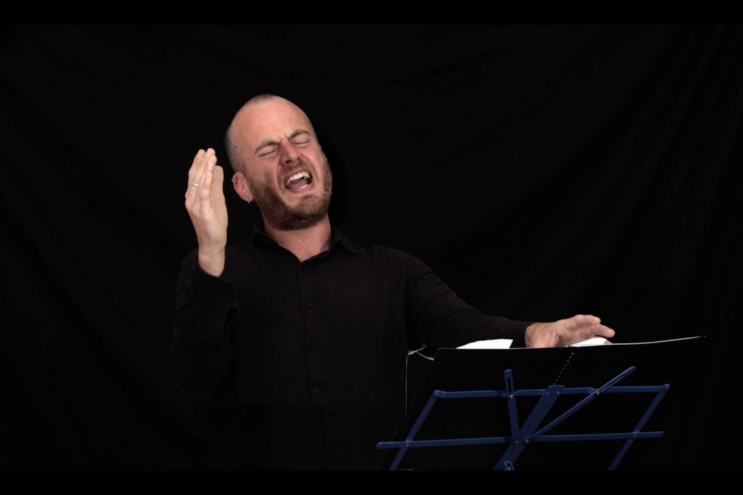man performing spoken word